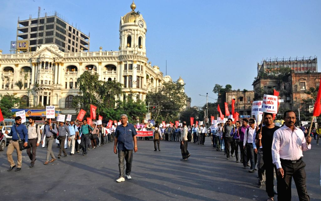 Members of All West Bengal Sales Representatives' Union participate in a protest rally against the Central and the State Government in Kolkata on Dec 4, 2019.