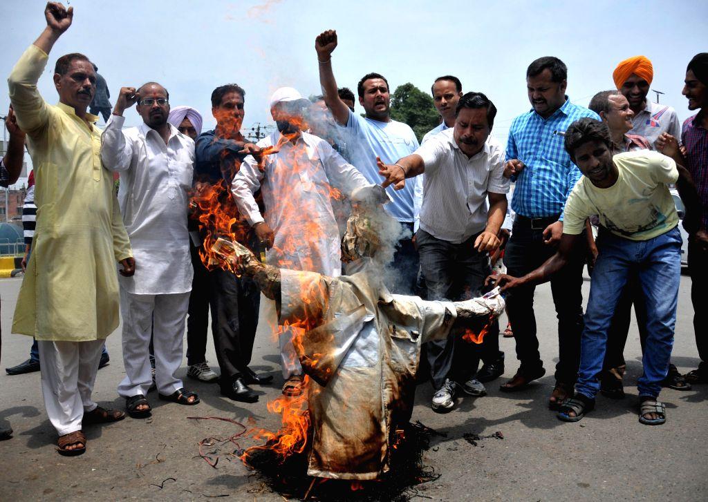 Members of Amaranth Sewa Mandala demonstrate against Jammu and Kashmir Chief Minister Omar Abdullah in Amritsar on July 18, 2014. - Omar Abdullah
