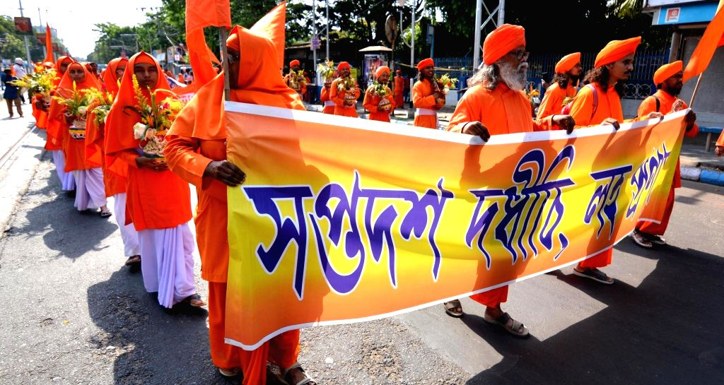 Members of Ananda Marga Pracharak Sangha participate in a protest rally demanding justice for the 16 monks and a nun of the order who were burnt alive on Bijon Setu in Kolkata on this day in ...