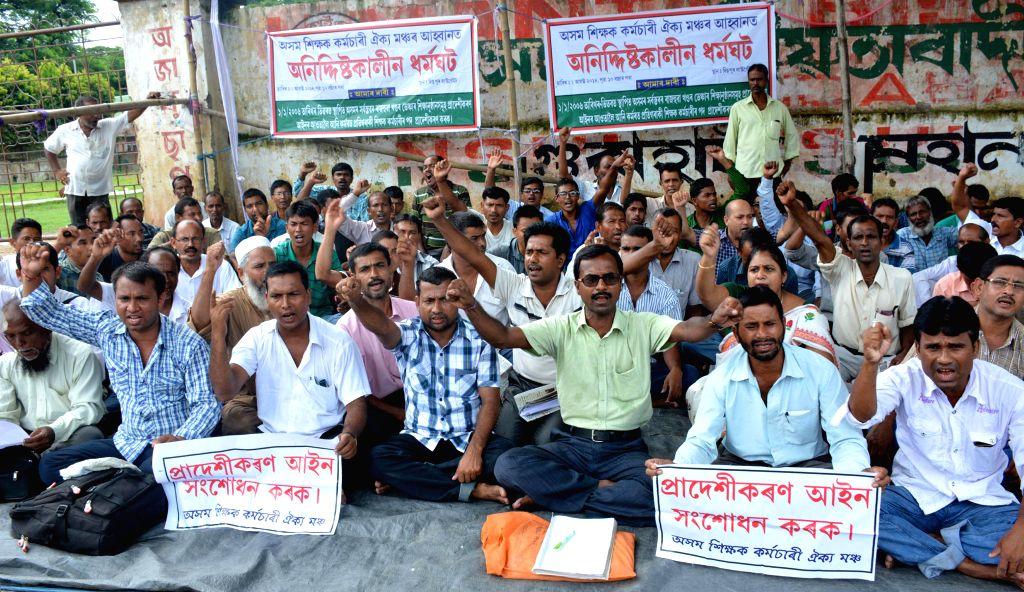 Members of Asom Sikshak Karmachari Oikyo Mancha (ASKOM) stage a demonstration in Guwahati on Aug 3, 2014.