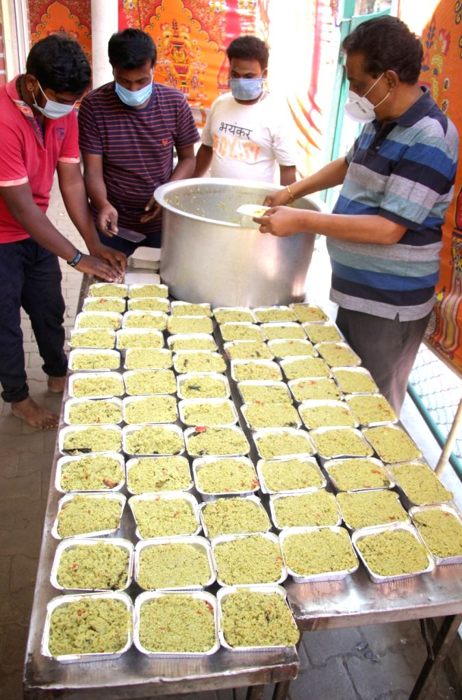 Members of Bandhava Trust make food packages to be distributed among the poor, needy and homeless on Day 6 of the 21-day countrywide lockdown imposed to contain the spread of novel ...