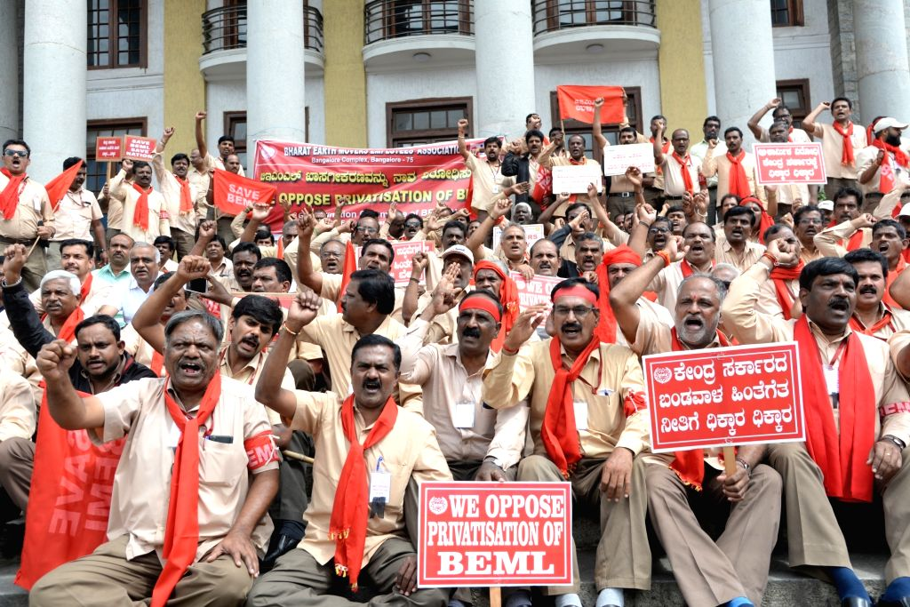 Members of BEML Limited Employee Association's Co-ordination Committee stage a demonstration against the Central Government over the privatization of BEML, in Bengaluru on Oct 26, 2019.
