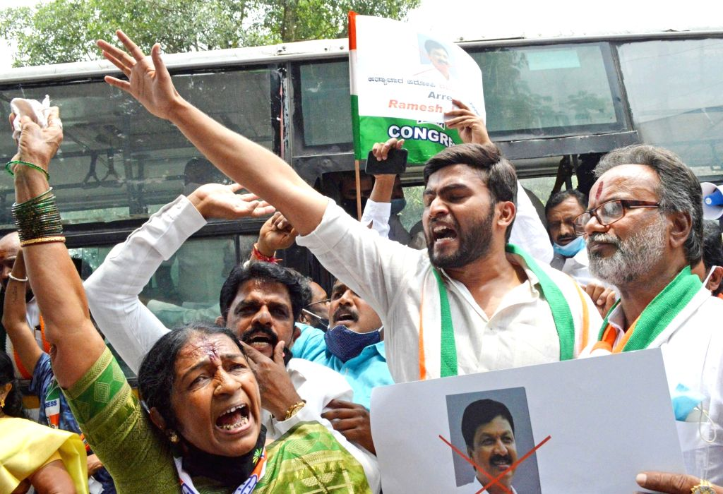 Members of Bengaluru Centre, South and North Zilla Congress Committee detained by police during their protest and demanding to arrest of former Minister and Gokak MLA Ramesh Jarkiholi, in Bengaluru ...