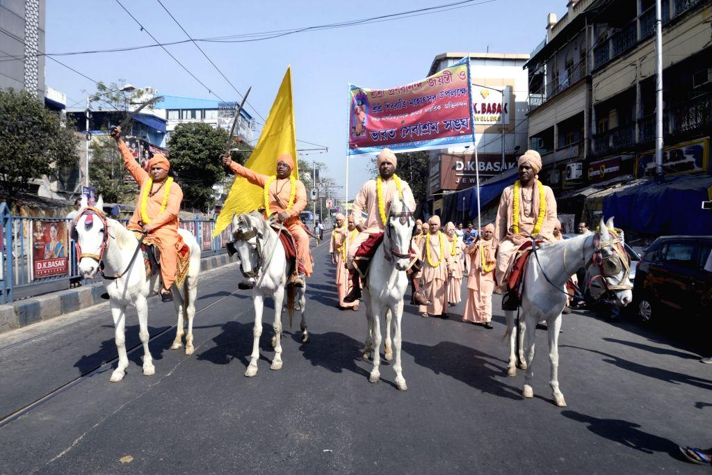 Members of Bharat Sevashram Sangha participate in a religious rally ahead of Maha Shivaratri in Kolkata on Feb 12, 2018.