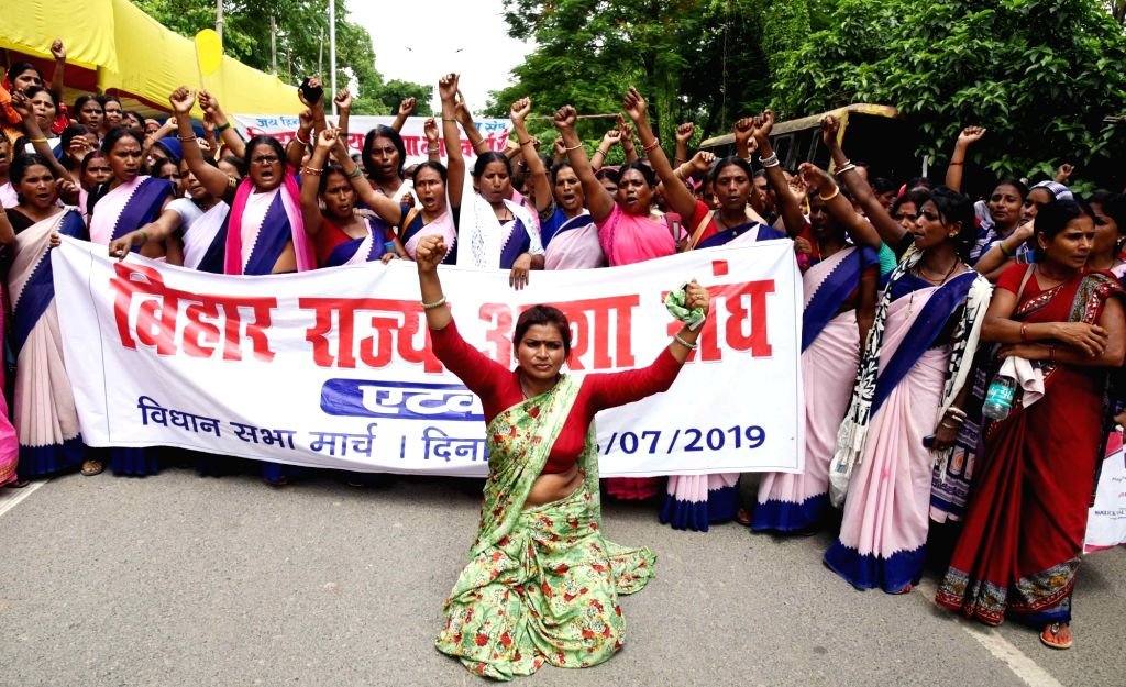 Members of Bihar Rajya Asha Sangh stage a demonstration to press for their various demands, in Patna on July 16, 2019.