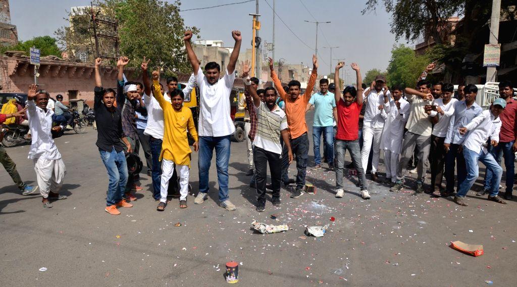 Members of Bishnoi community celebrate outside the Jodhpur rural court that sentenced actor Salman Khan to five years of imprisonment in the 1998 black buck poaching case, in Jodhpur on ... - Salman Khan and Saif Ali Khan