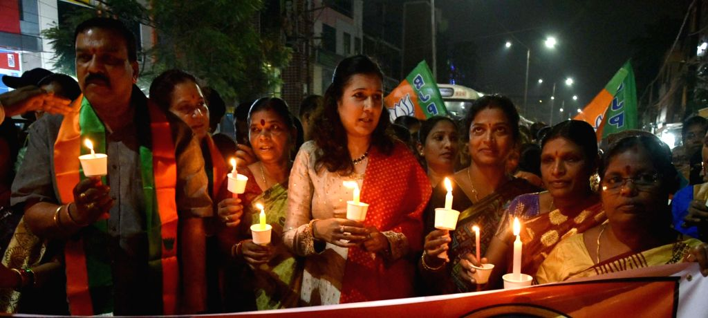 Members of BJP Mahila Morcha participate in a candlelight vigil to protest against the gruesome gang rape and murder of a woman veterinarian in Hyderabad; on Dec 2, 2019.