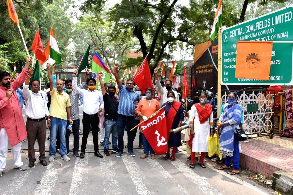 Members of Central Coalfields Limited (CCL), a subsidiary of Coal India Limited protest against the privatisation of coal mines, outside Raj Bhawan in Ranchi on July 3, 2020. The government ...