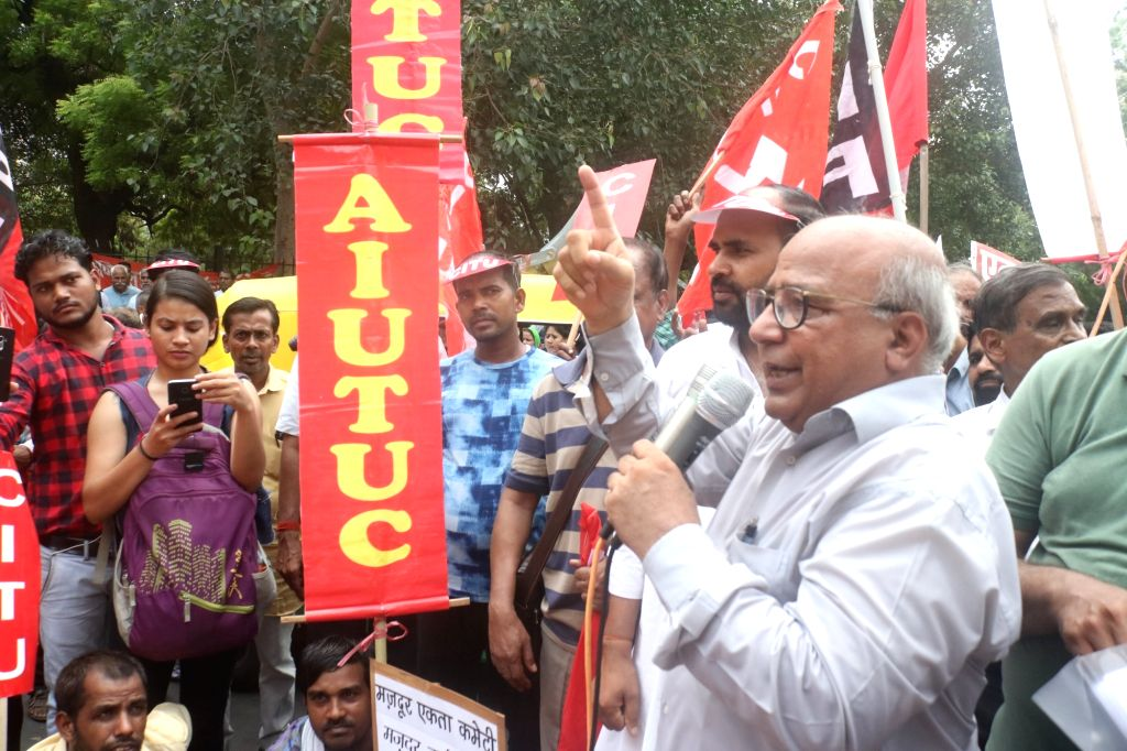 Members of Central Trade Unions stage a demonstration against the Code on Wages Bill 2019 and the Occupational Safety, Health and Working Conditions Code Bill 2019 that have been ...