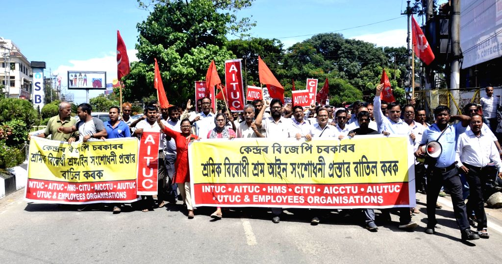 Members of Central Trade Unions stage a demonstration against the Code on Wages Bill 2019 and the Occupational Safety, Health and Working Conditions Code Bill 2019 that have been introduced ...