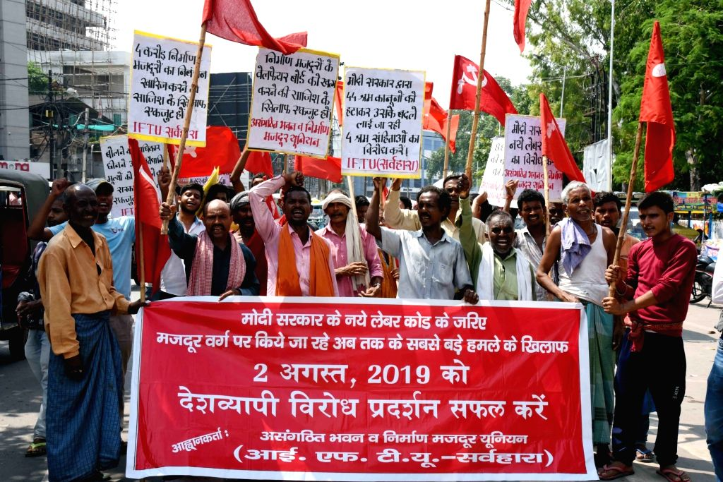 Members of Central Trade Unions stage a demonstration against the Code on Wages Bill 2019 and the Occupational Safety, Health and Working Conditions Code Bill 2019 that have been introduced in ...