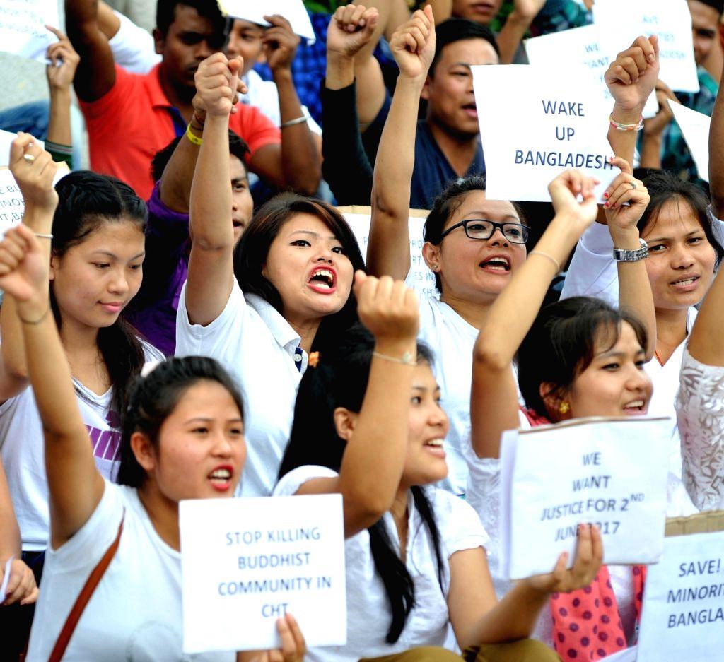 Members of Chakma Students' Association of Karnataka stage a demonstration against Bangladesh in Bengaluru, on June 18, 2017.