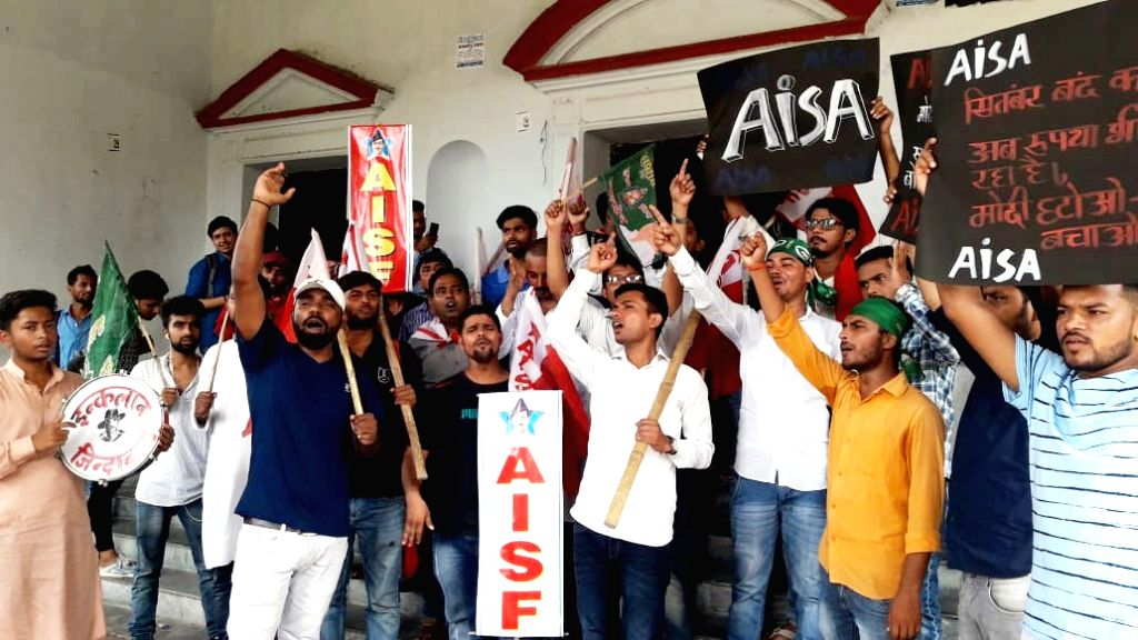 Members of CPI-ML's student wing - All India Students Association (AISA) stage a demonstration during a nationwide shutdown protest - 'Bharat Bandh' against rising fuel prices called by ...