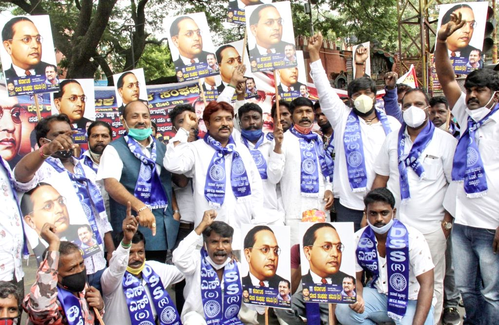 Members of Dalit Sangharasha Samiti (DSS) raise slogans during a protest over recent incidents of violence against Pulikeshinagar's Congress MLA Akhanda Srinivas Murthy on Tuesday night ...