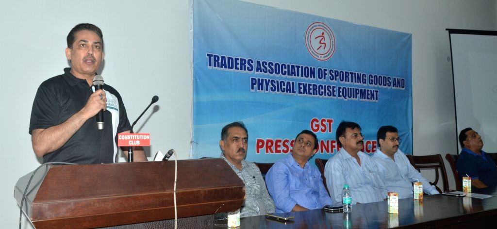 Members of Delhi Traders Association of Sporting Goods and Physical Exercise Equipment (TASGPEE) during a press conference organised to point out adverse affects of GST on their trade in ...