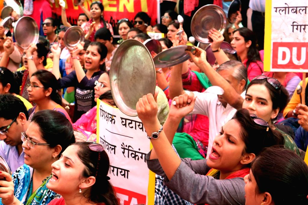 Members of Delhi University Teachers Association (DUTA) stage a demonstration to press for their demands in New Delhi, on June 6, 2016.