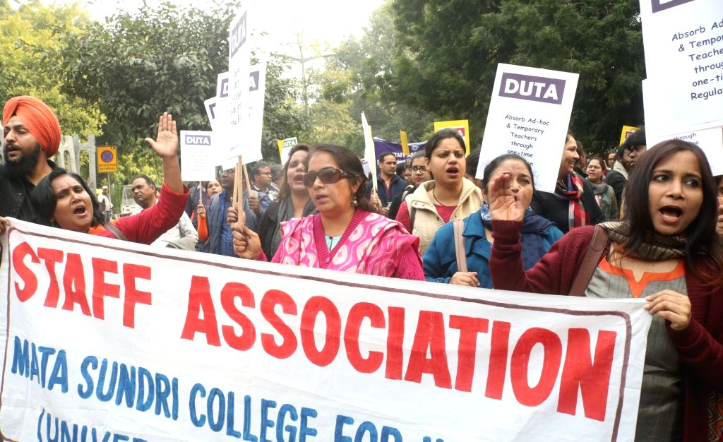Members of Delhi University Teachers' Association (DUTA) participate in a rally to protest against Union Human Resource Development (HRD) Minister Prakash Javadekar in New Delhi, on Feb 5, ... - Prakash Javadekar