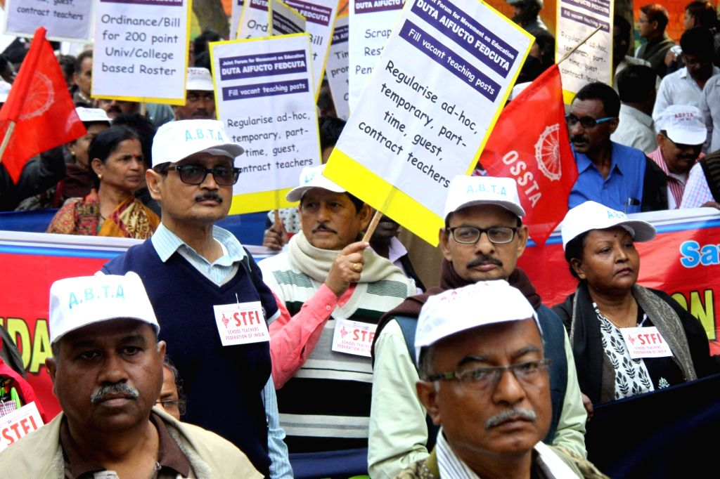 Members of Delhi University Teachers' Association (DUTA) stage a demonstration to press for their demands in New Delhi, on Feb 19, 2019.