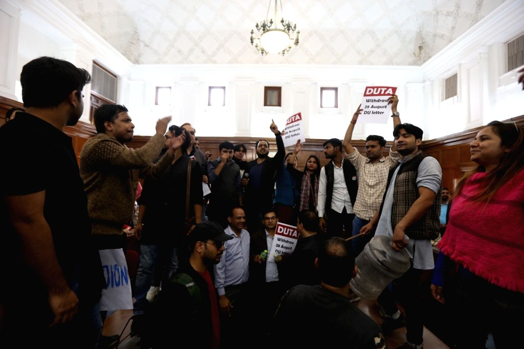 Members of Delhi University Teachers' Association (DUTA) stage a demonstration against the Vice-Chancellor, demanding the appointment, absorption and promotion of ad-hoc teachers, in New ...