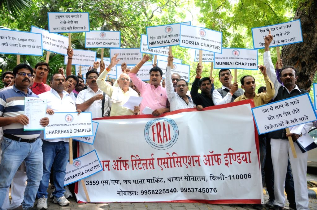 Members of Federation of Retailer Association of India (FRAI) stage a demonstration to express concerns over trade and product restrictions for outlets selling multiple products of daily ...