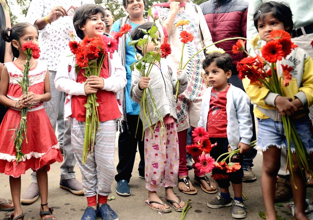 Members of Flower Growers of Karnataka and Farmers of South India Floriculture Association distributed free 10 Lakh flowers to the public at Lalbhag to create awareness to the public not ...