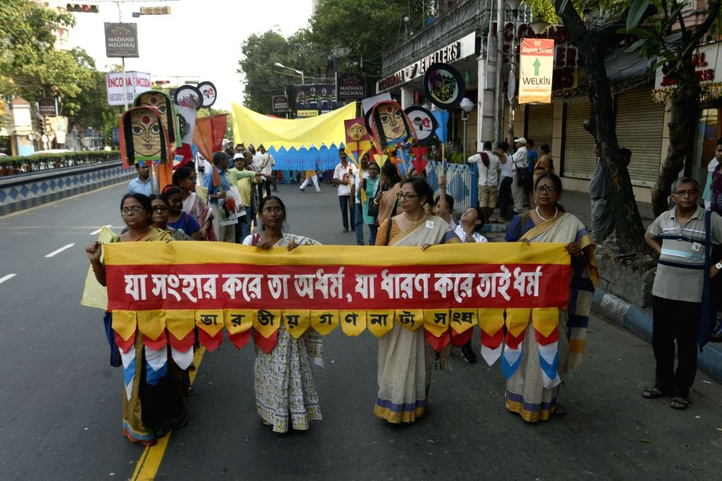 Members of Gananatya Sangha participate in a rally to celebrate 75th anniversary of the theatre group, in Kolkata on May 27, 2018.