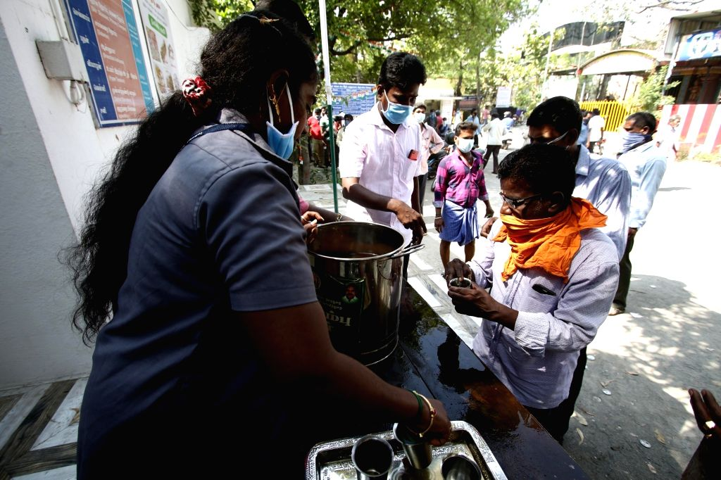 Members of Government Ayurvedic Medical College distribute herbal syrup among people to help them stay immune against coronavirus on Day 7 of the 21-day nationwide lockdown imposed to ...
