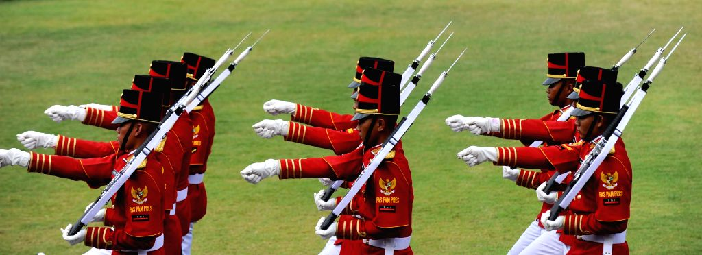 Members of honor guards participate in a celebration marking the 70th anniversary of Indonesia's independence in Jakarta, Indonesia, Aug. 17, 2015. (Xinhua/Agung ...