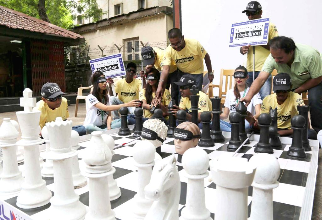 Members of IDL Foundation demonstrate blind chess during press conference regarding Chess Blackathon Karnataka State level Blind chess competition - 2016, in Bengaluru on June 17, 2016.