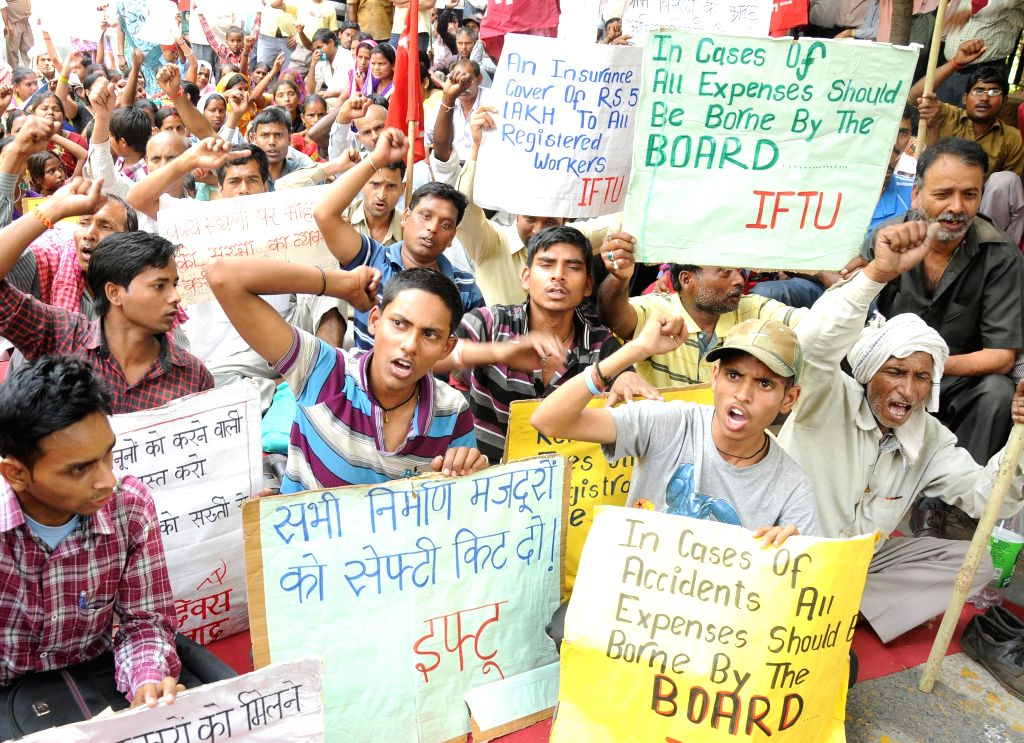 Members of Indian Federation of Trade Unions demonstrate to press for abolition of contract labour system, on International Workers' Day in New Delhi on May 1, 2014.