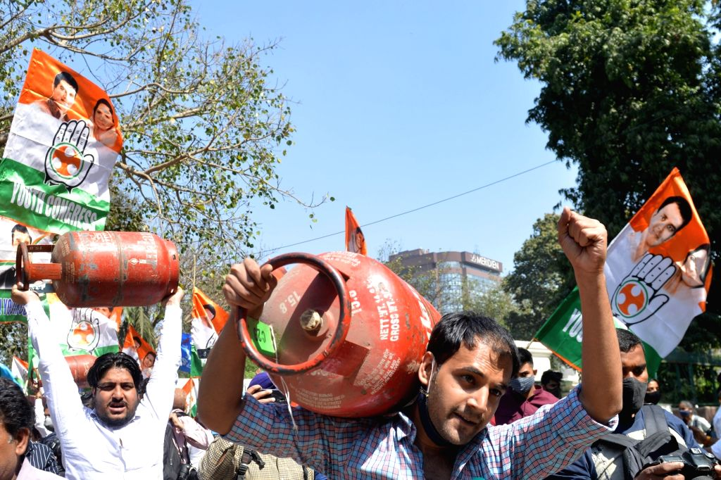 Members of Indian Youth congress holding a protest against price rise of fuel and lpg gas outside Shastri Bhavan in Delhi on Tuesday 02nd March, 2021.