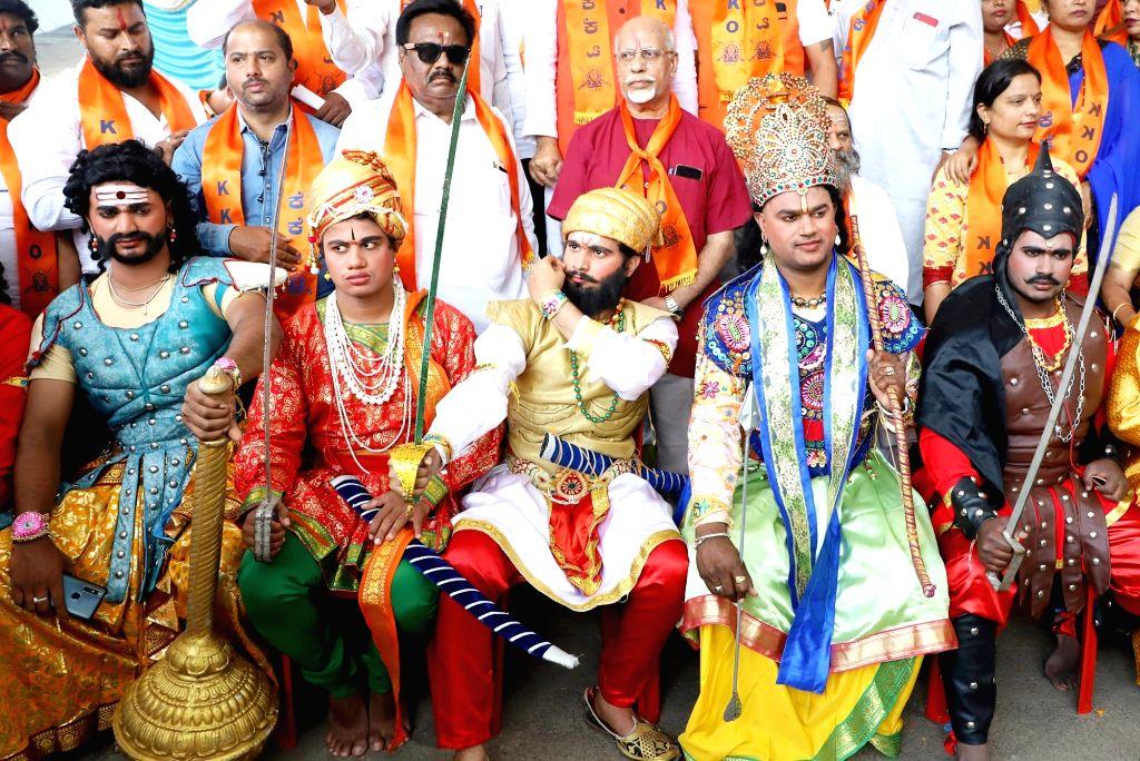 Members of Karnataka Kshatriya Association dressed up in various costumes, stage a demonstration to press for their various demands, in Bengaluru on Sep 28, 2019.