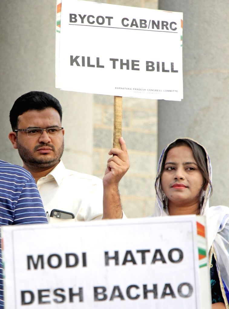 Members of Karnataka Pradesh Congress Committee (KPCC) Minorities Cell stage a demonstration against NRC and Citizenship Amendment Bill (CAB) 2019, in Bengaluru on Dec 12, 2019.