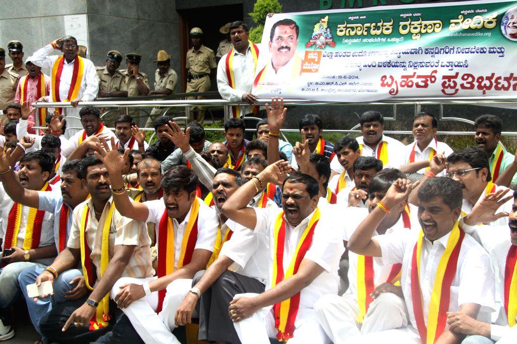 Members of Karnataka Rakshana Vedike (KRV) demonstrate to demand jobs for Kannadigas in Bangalore Metro Rail Corporation Ltd at Shanti Nagar of Bangalore on June 19, 2014.
