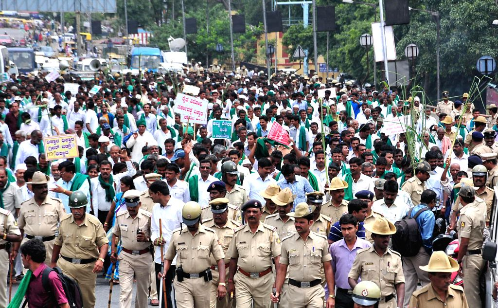 Members of Karnataka State Sugarcane Growers Association demonstrate to press for payment of their dues by the sugar factories and other demands in Bangalore on June 20, 2014.