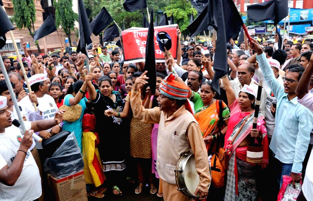 Members of Konkan Refinery Virodhi Sangharsh Sanghatna stage a demonstration to protest against Nanar refinery project outside Dadar Railway Station in Mumbai on July 16, 2018.