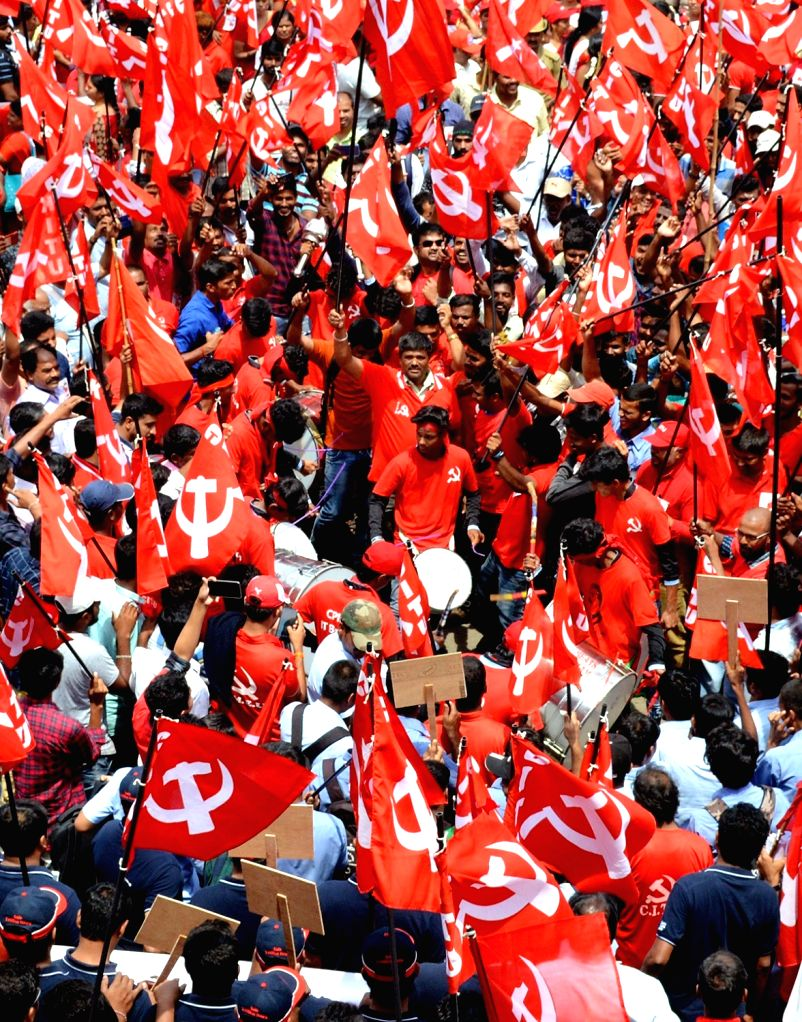 Members of Leftist trade unions participate in a rally on International Labour Day, in Bengaluru on May 1, 2019.