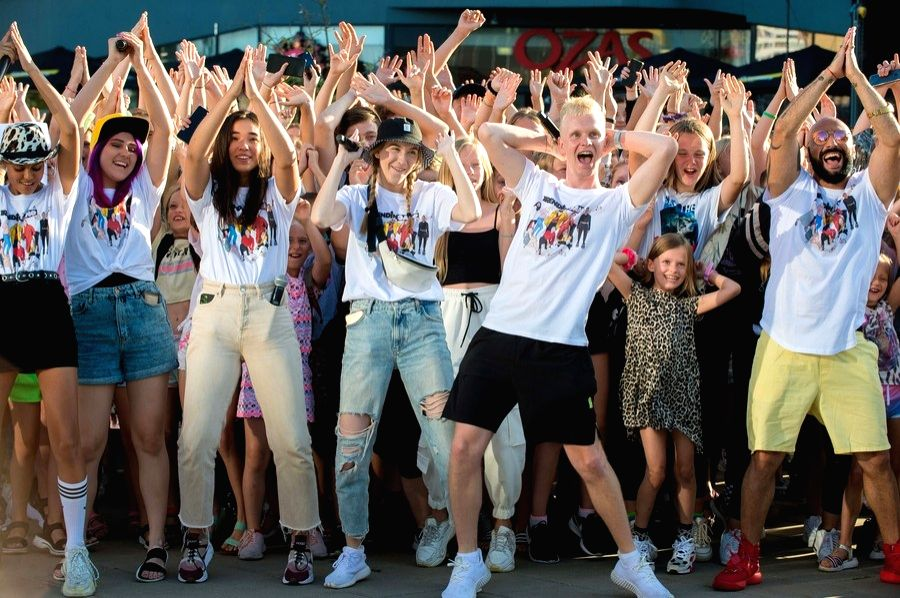 """Members of local social media star """"The Trending Gang"""" dance with fans during a TikTok filming session in Vilnius, Lithuania, Aug. 10, 2020."""