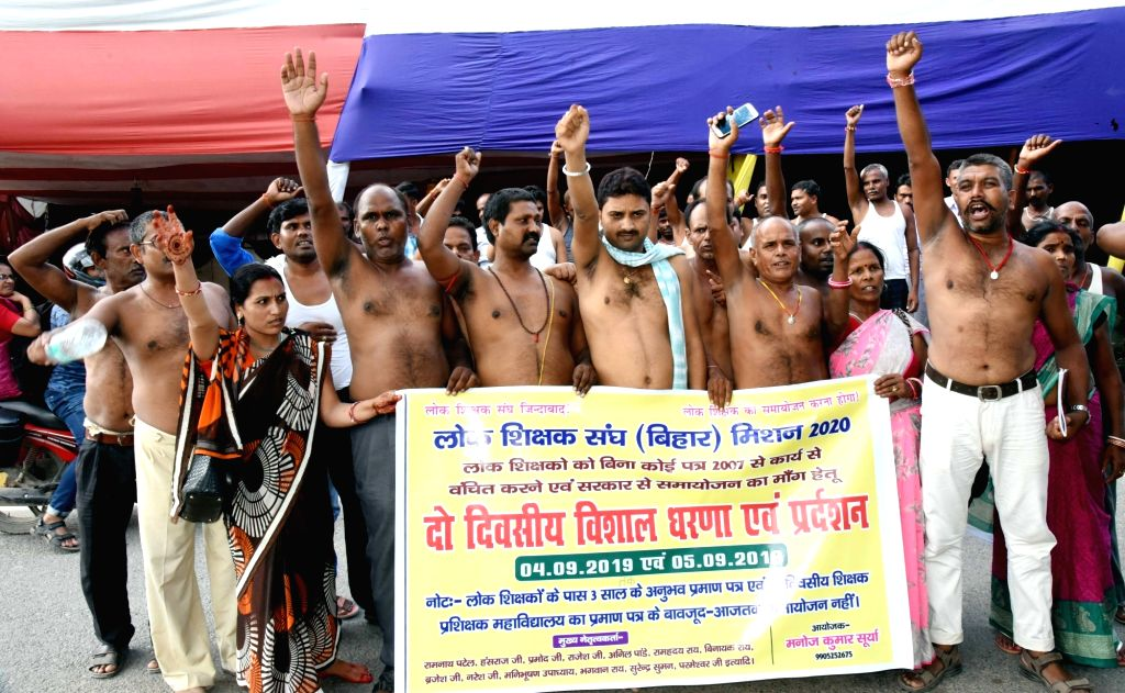 Members of Lok Shikchak Sangh stage a demonstration to press for their various demands in Patna on Sep 4, 2019.
