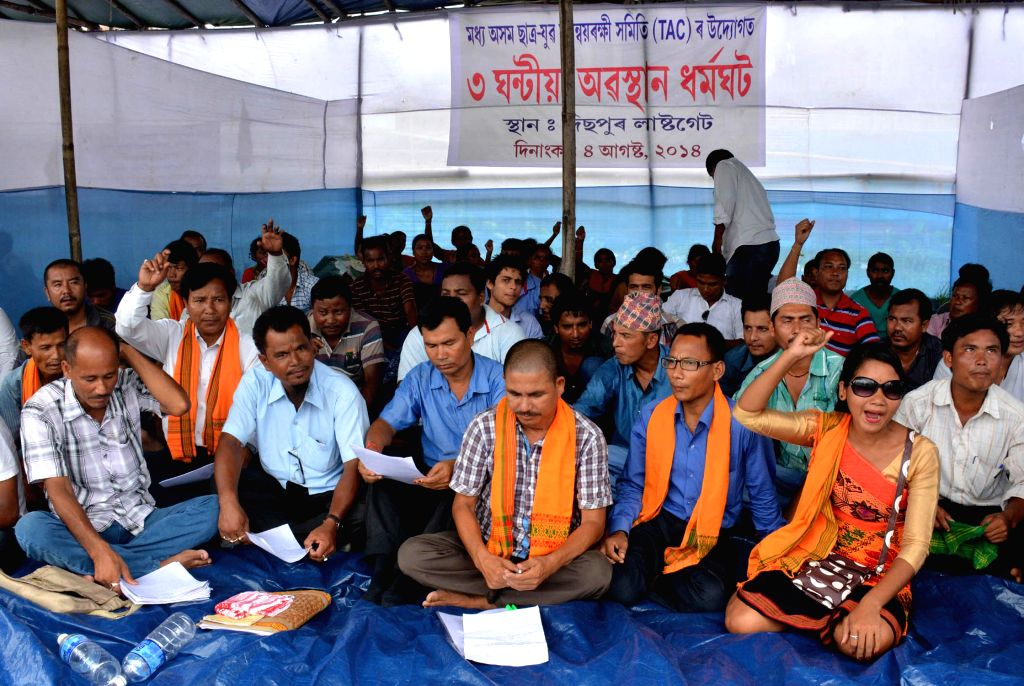 Members of Madhya Asom Chatra-yuba Samannayrakhi Samiti (TAC) stage a demonstration to press for their demonstration at Dispur Last Gate in Guwahati on Aug 4, 2014.