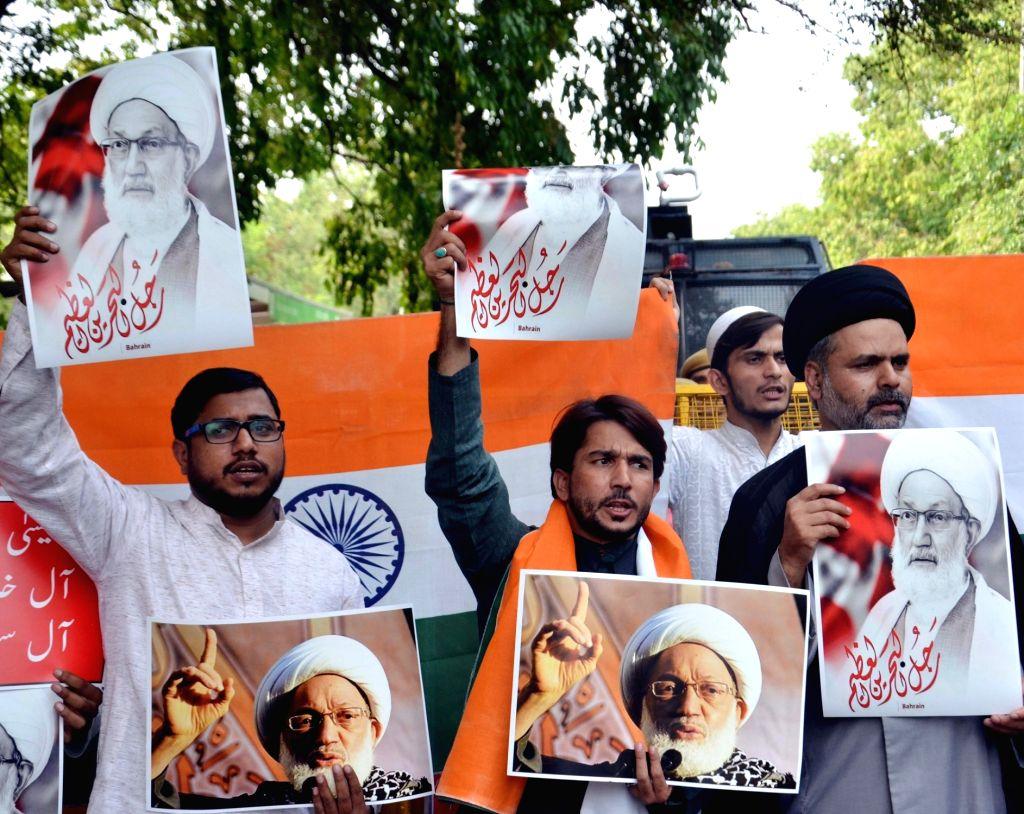 Members of Majlis-e-Ulama-e-Hind (MUH), an all India organization of Shia clerics shout slogans against the governments of Bahrain, Saudi Arabia and Israel outside the United Nations ...