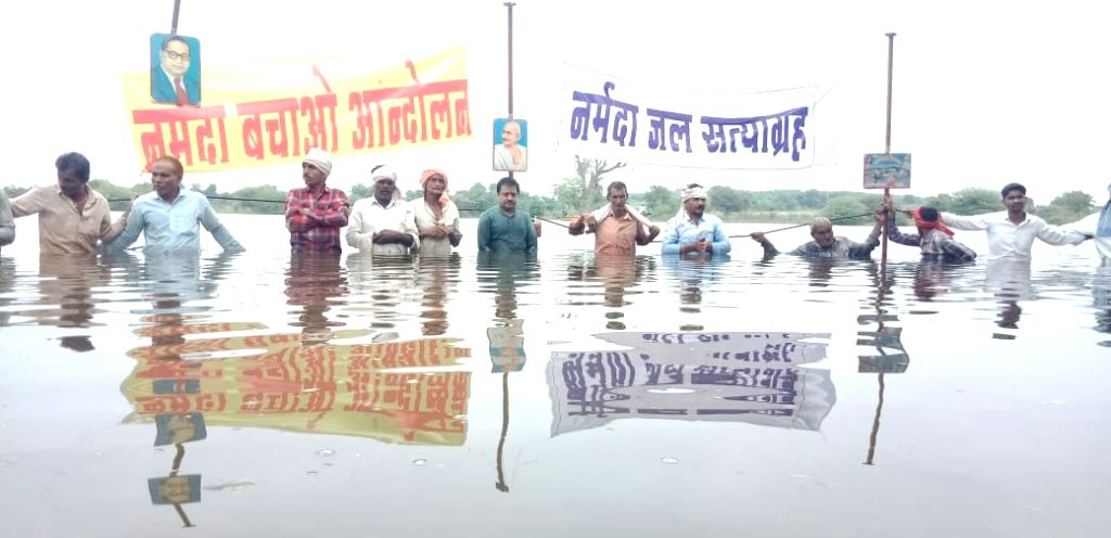 Members of Narmada Bachao Andolan (NBA) stage 'Jal Satyagrah' to protest against filling of Omkareshwar dam to the height of 193 metres, in Kaman Kheda village of Madhya Pradesh's Khandwa district on ...