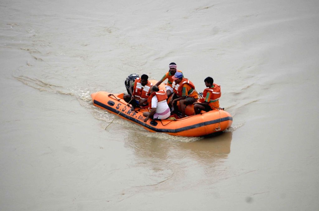 Members of National Disaster Response Force (NDRF) carry out rescue operations after a car fell into the swollen Ganga river, in Patna on July 31, 2018.