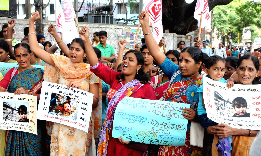 Members of National Federation of Indian Women demonstrate against Israeli attacks on Gaza in Bangalore on July 20, 2014.