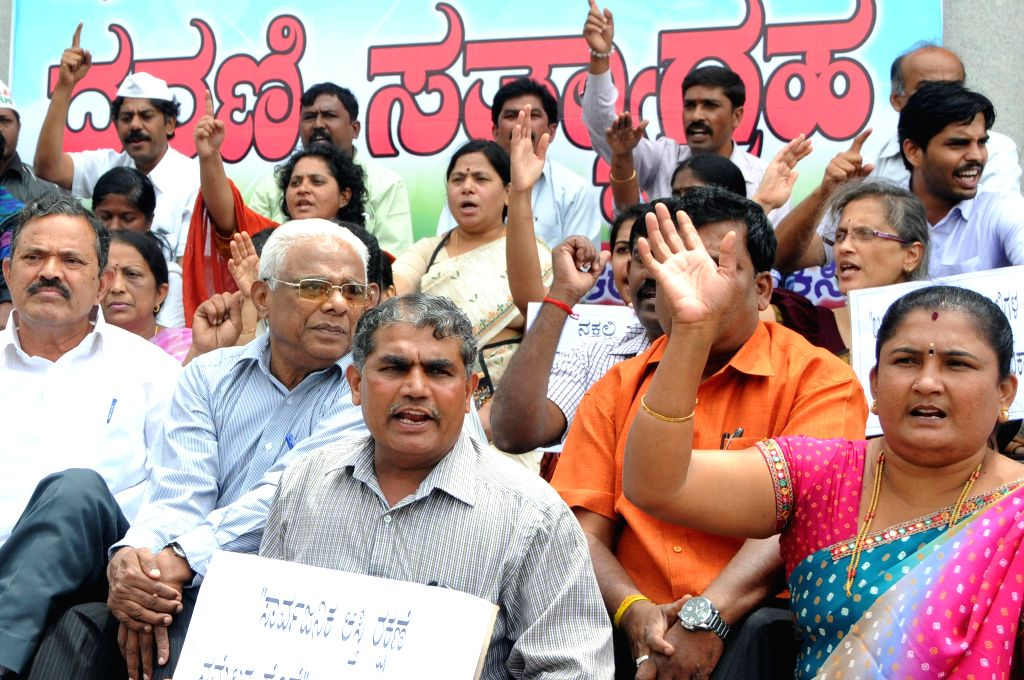 Members of National Federation of Indian Women and Aam Aadmi Party (AAP) leaders stage a demonstration against land mafias in Bangalore on Sept 8, 2014.