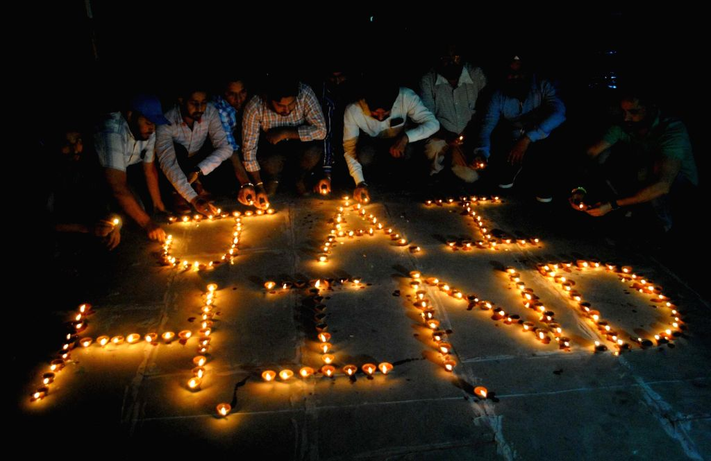Members of National Human Rights and crime control organisation pay tribute to soldiers with formation of Jai Hind made with earthen lamps for the soldiers who had achieved martyrdom in ...