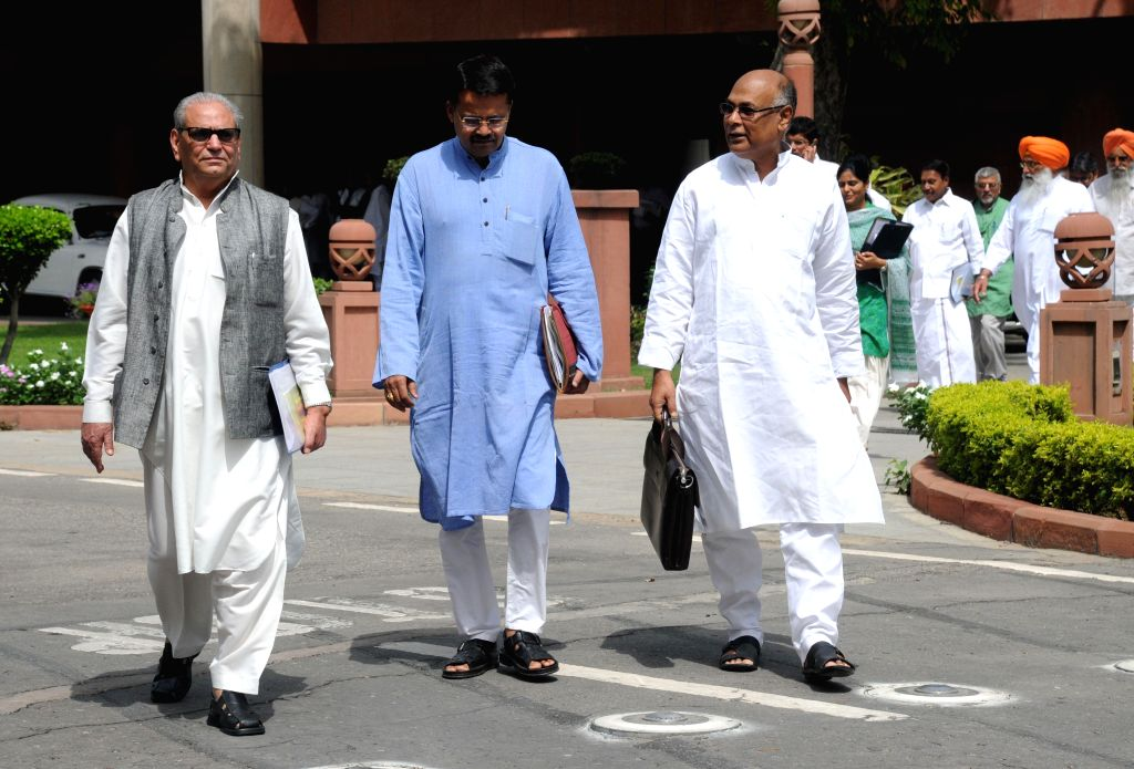 Members of Parliament arrive to attend the budget session of the Parliament in New Delhi on July 7, 2014.