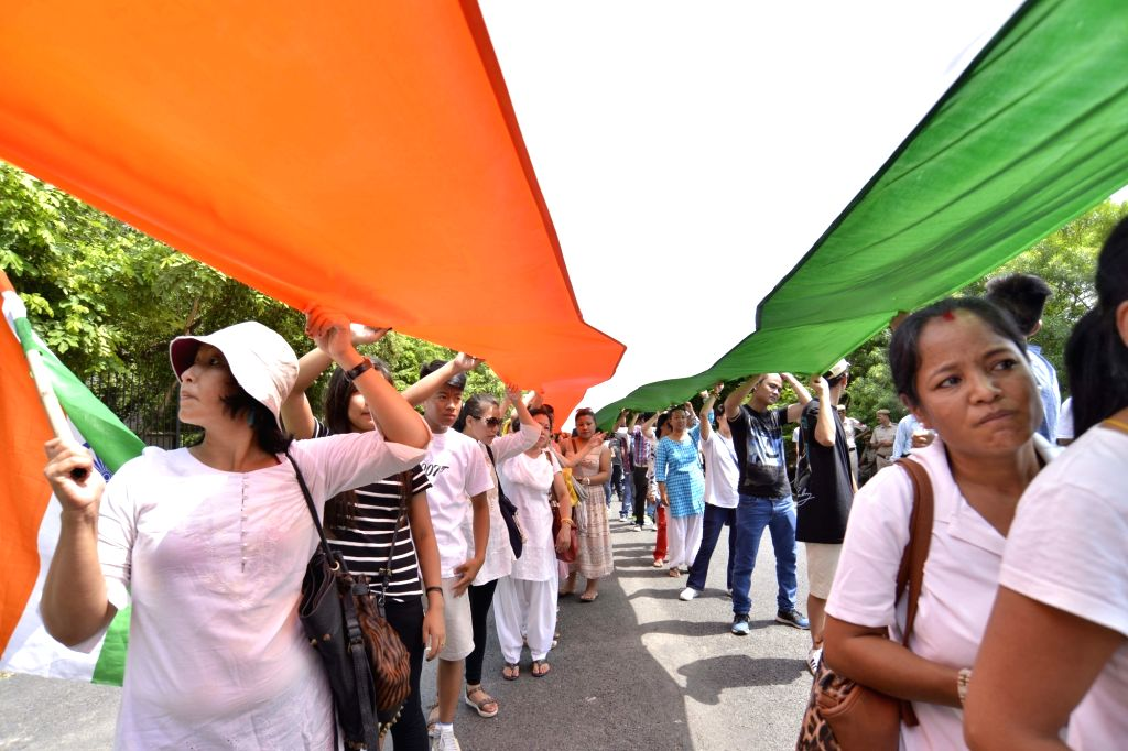 Members of People's Movement for Gorkhaland participate in a march organised from Rajghat to Jantar Mantar to press for formation Gorkhanland in New Delhi, on July 9, 2017.