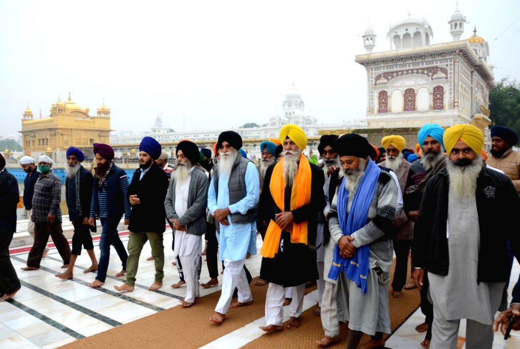 Members of radical Sikh organisation Dal Khalsa on their way to start their journey for New Delhi after offering prayers at the Golden Temple, in support of farmers agitation, in Amritsar ...