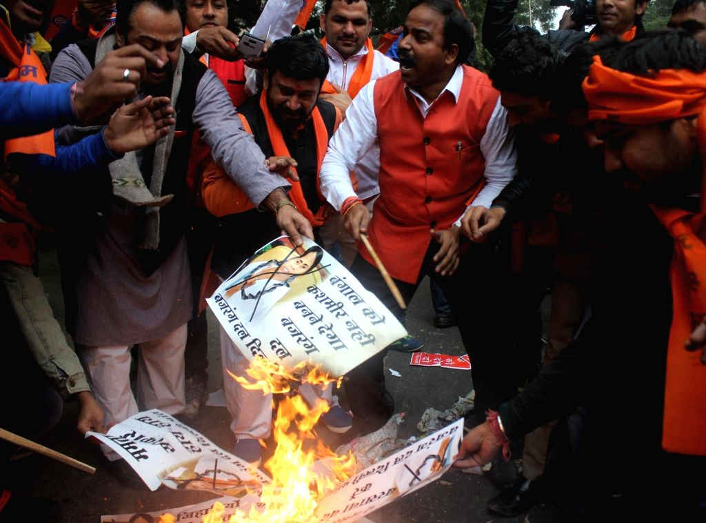 Members of right-wing organisation stage a demonstration against West Bengal Chief Minister Mamata Banerjee outside Banga Bhawan in New Delhi, on Jan 15, 2016. - Mamata Banerjee